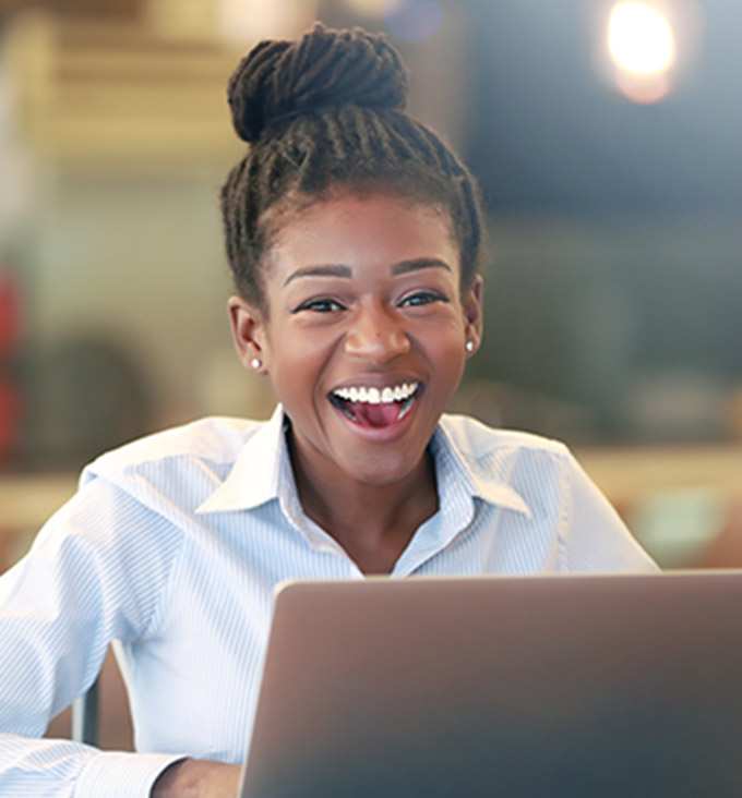 Black woman smiling on computer