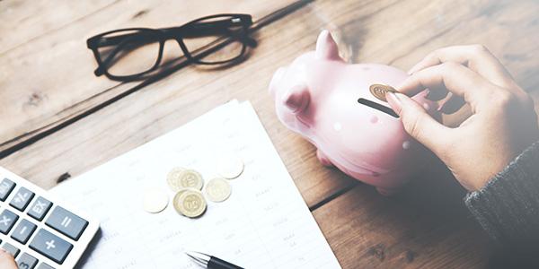 Putting money in piggy bank