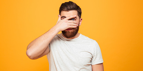 Bearded man on orange background