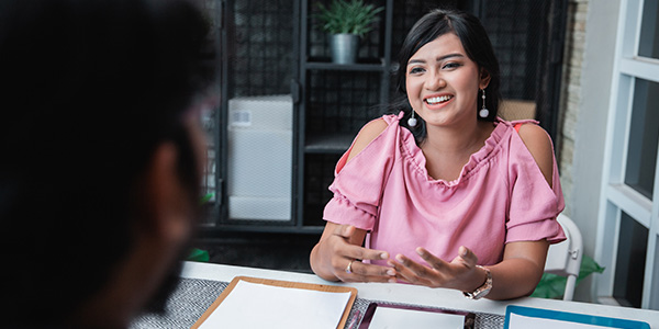 Beautiful woman smiling in interview